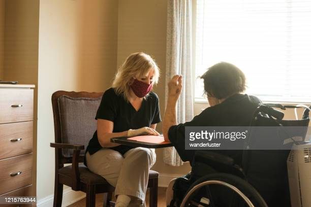 speech therapy during covid-19 - care home stock pictures, royalty-free photos & images