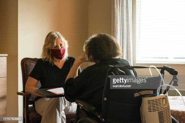 speech therapy during covid-19 - nursing home stock pictures, royalty-free photos & images