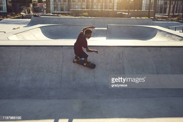 speed and balance is a powerful combo - half pipe stock pictures, royalty-free photos & images