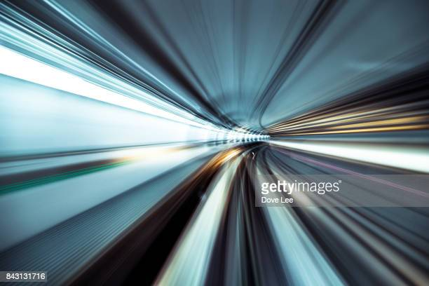 speed and motion in tunnel - bewegung stock-fotos und bilder