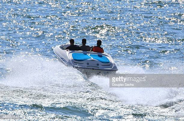 Speed boat making wake in on the water