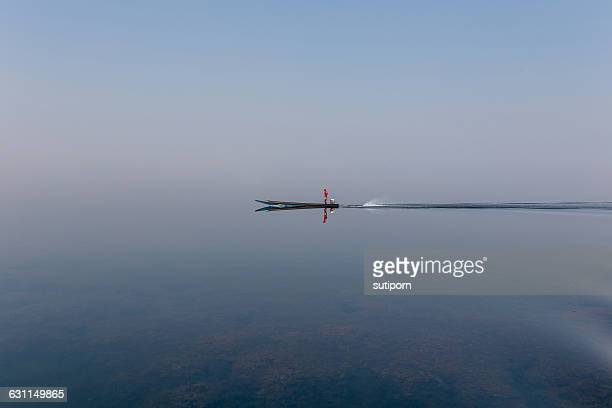 Speed boat sailing across lake