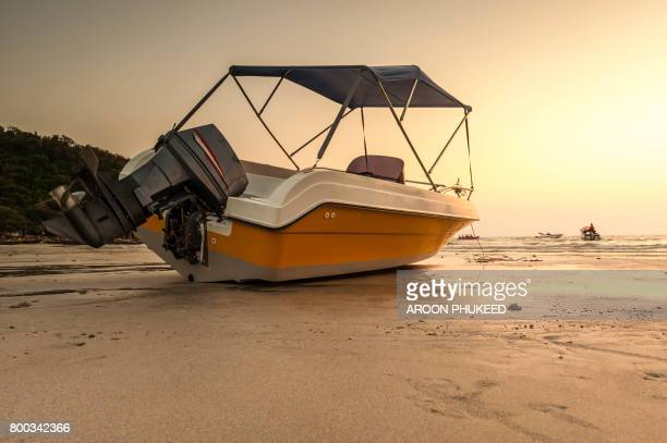 Speed boat with sunset background