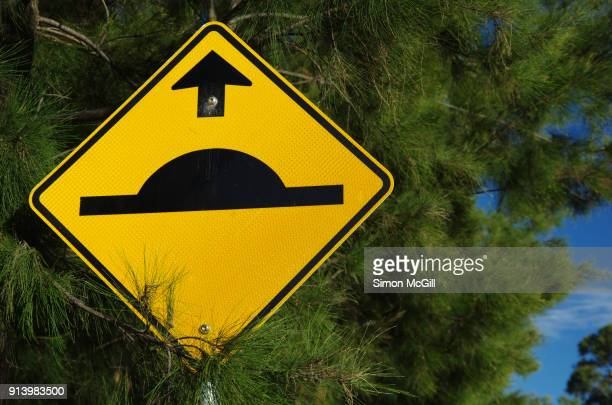 Speed bump ahead traffic warning sign