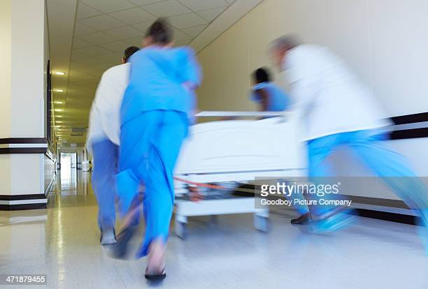 speed is of the essence - saving lives - hospital gurney stock pictures, royalty-free photos & images