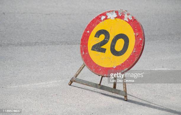 speed limit sign 20 km/h, changing cement pipes for plastic pipes - number 20 stock pictures, royalty-free photos & images