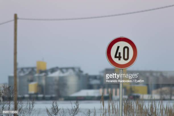 speed limit sign against factory - number 40 stock photos and pictures