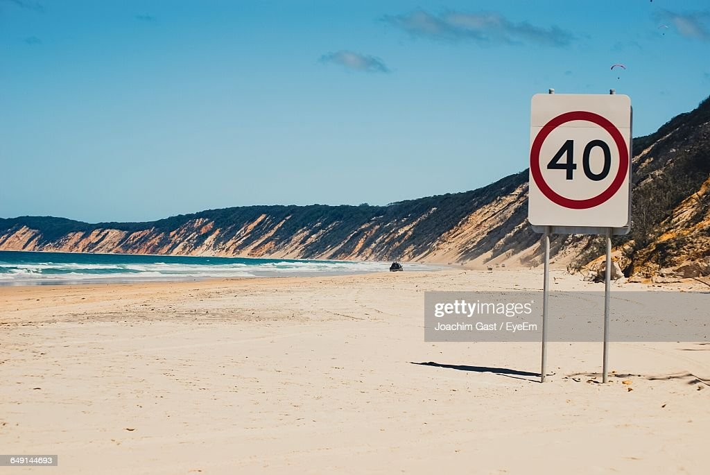 Speed Limit Sign At Beach Against Sky : Stock Photo