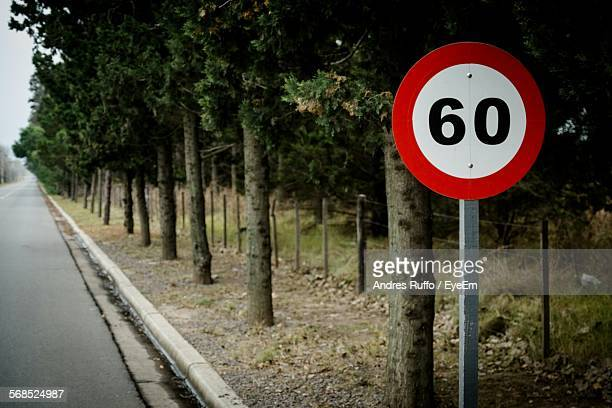 speed limit sign at roadside - number 60 stock photos and pictures
