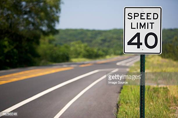 speed limit sign by the road - speed limit sign stock photos and pictures