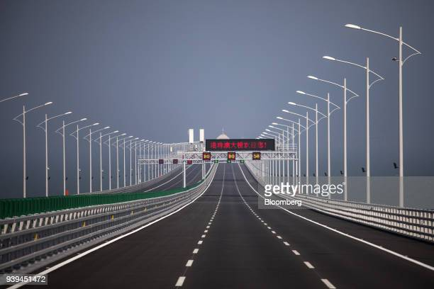 Speed limits are seen on signs at a section of the Hong KongZhuhaiMacau Bridge during a media tour of the bridge offshore in Zhuhai China on...