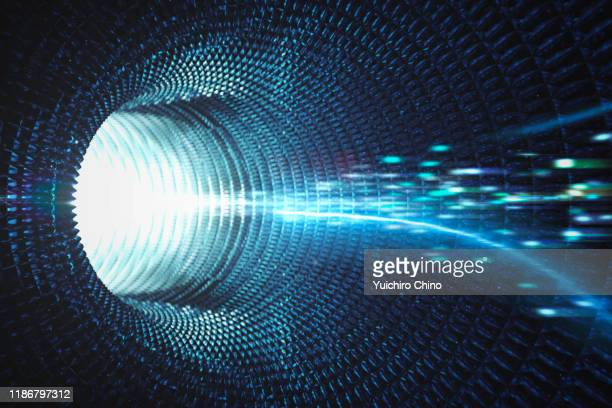 speed motion quantum in tunnel - tunnel stock pictures, royalty-free photos & images