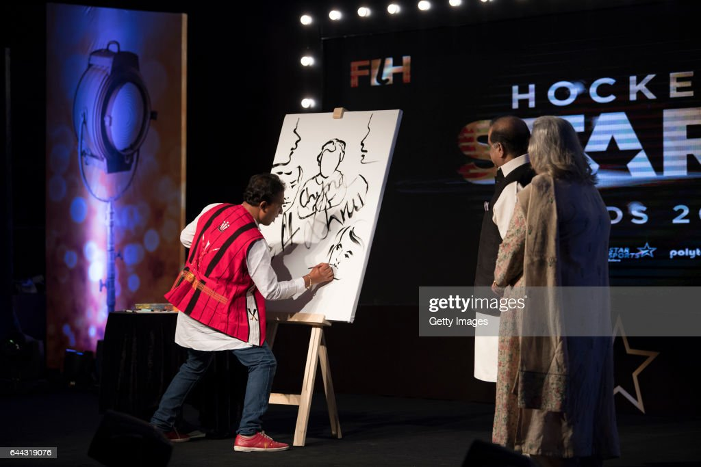 Speed Painter Rabin Bar of Assam sketches a painting of the signatures of Dr Narinder Dhruv Batra President of The International Hockey Federation...