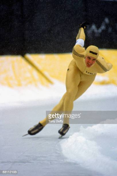 US speed skater Eric Heiden makes his way around a bend tucking low with both arms behind his back during the1980 Winter Olympic games in February...