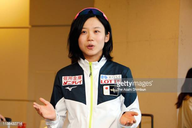 Speed skater Miho Takagi speaks to media reporters on arrival at Narita International Airport on March 12 2019 in Narita Chiba Japan