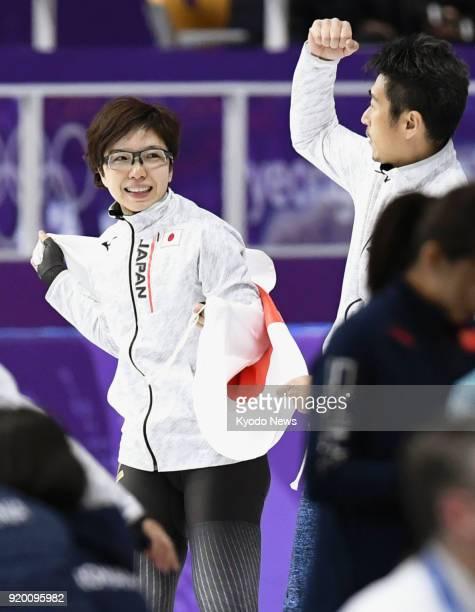 Speed skater Nao Kodaira of Japan celebrates with her coach Masahiro Yuki after winning the women's 500meter speed skating gold medal at the...