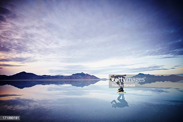 speed skater skating on calm lake at sunset - agility stock pictures, royalty-free photos & images