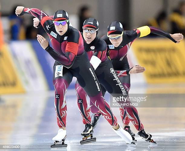Speed skaters Bente Kraus Claudia Pechstein and Gabriele Hirschbichler of Germany skate in the women's team pursuit Division A at the ISU World Cup...
