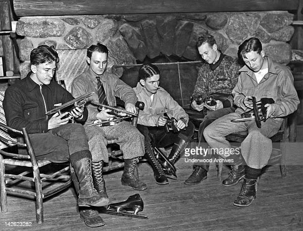 Speed skaters check their blades in preparation for the 1924 Winter Olympic tryouts to be held under the eye of Coach William Taylor at Brentmere...