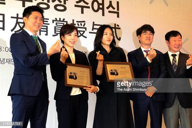 Speed skaters Nao Kodaira of Japan and Lee SangHwa of South Korea attend the award ceremony of the KoreaJapan Friendship prize on April 07 2019 in...