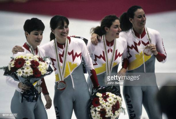 1992 Winter Olympics Canada Annie Perreault Sylvie Daigle Angela Cutrone and Nathalie Lambert victorious with gold medals after Women's 3000M Relay...