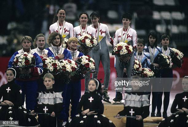 1992 Winter Olympics Canada Sylvie Daigle Annie Perreault Angela Cutrone and Nathalie Lambert victorious with gold medals after Women's 3000M Relay...