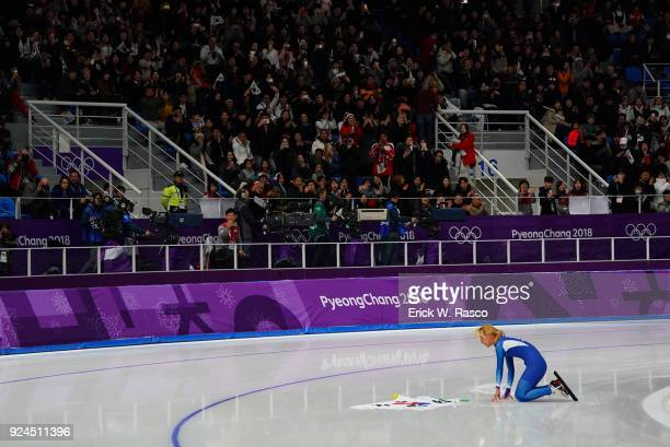 2018 Winter Olympics South Korea Kim BoReum victorious down on her knees on ice with flag after Women's Mass Start Final at Gangneung Oval BoReum...