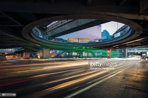 speed traffic - light trails on motorway highway at night, long exposure abstract urban background - integrated stock pictures, royalty-free photos & images