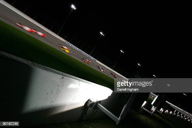 Speed under the lights race action during the IRL IndyCar Series PEAK Antifreeze Motor Oil Indy 300 on August 29 2009 at the Chicagoland Speedway in...