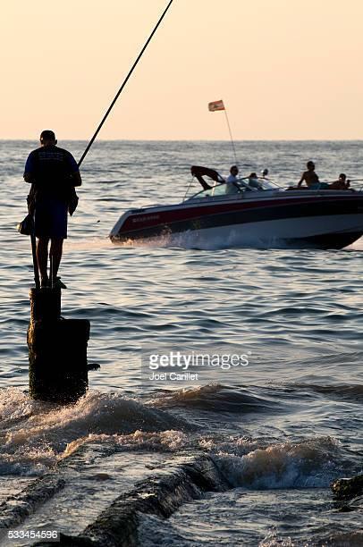 Speedboat and fisherman in Beirut, Lebanon
