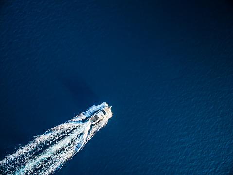 Speedboat racing along the open sea 505972648