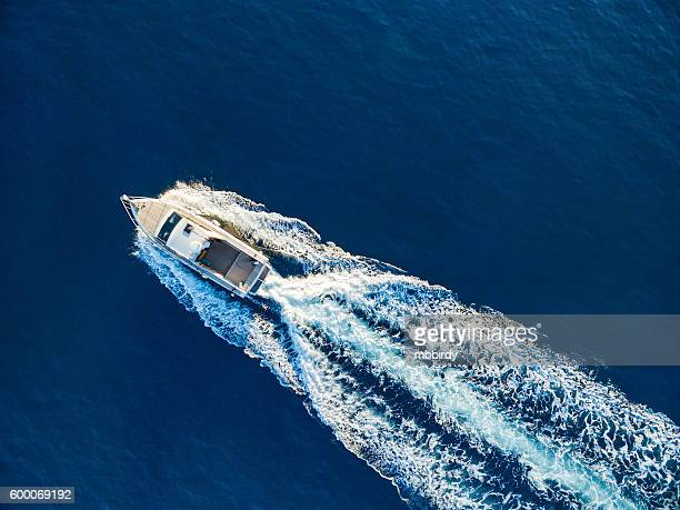 speedboat racing at the open sea - small boat stock pictures, royalty-free photos & images