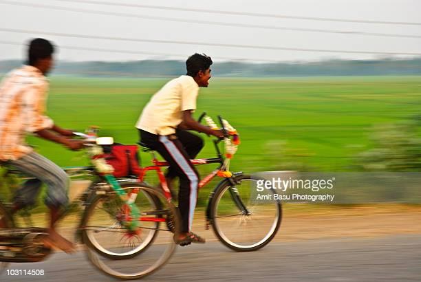 Speeding bicyclists on a village road