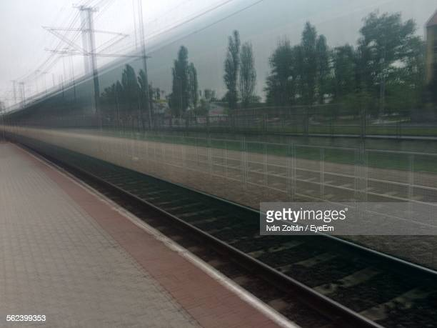 speeding blurred train at railway station - iván zoltán stock pictures, royalty-free photos & images