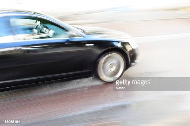 Speeding car in the city