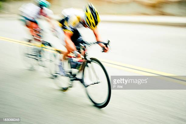 Speeding cyclists with abstract blur