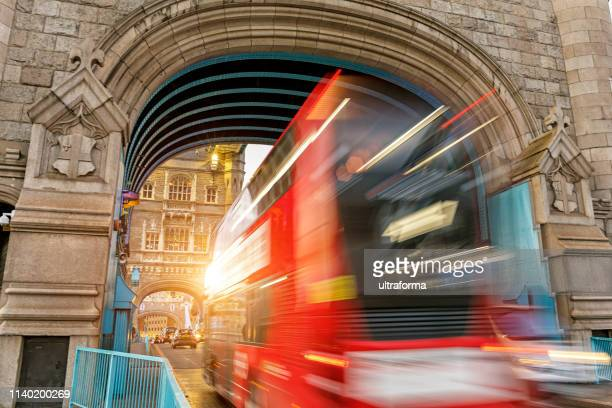 speeding double-decker on tower bridge in london - cross processed stock pictures, royalty-free photos & images