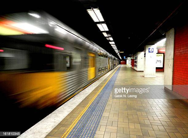 CONTENT] Speeding fast train with motion blur leaving at Town Hall Railway Station Sydney Image of an empty underground railway station with lighting...