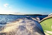speeding fishing motor boat with drops