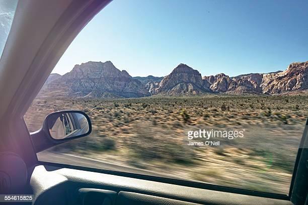 speeding landscape from car window