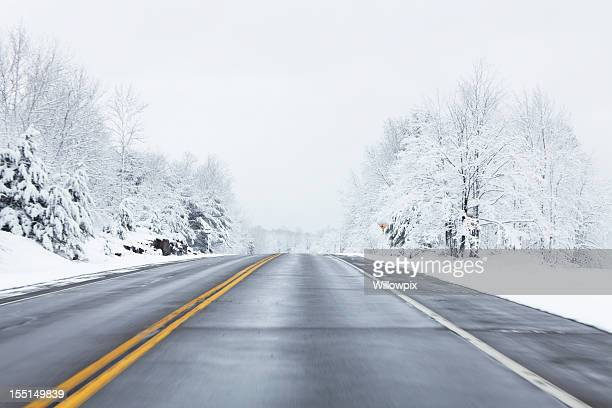 speeding on winter highway - snow storm stock pictures, royalty-free photos & images