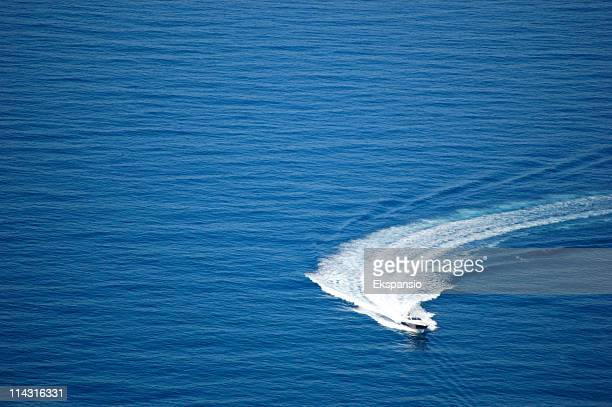 speeding round the mediterranean - recreational boat stock pictures, royalty-free photos & images