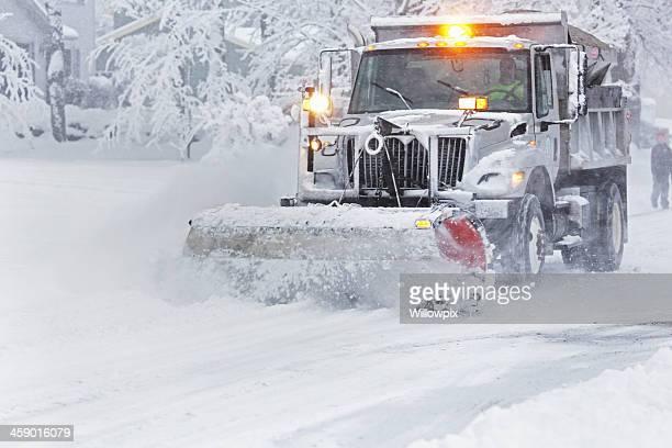speeding suburban snowplow - snowplow stock pictures, royalty-free photos & images
