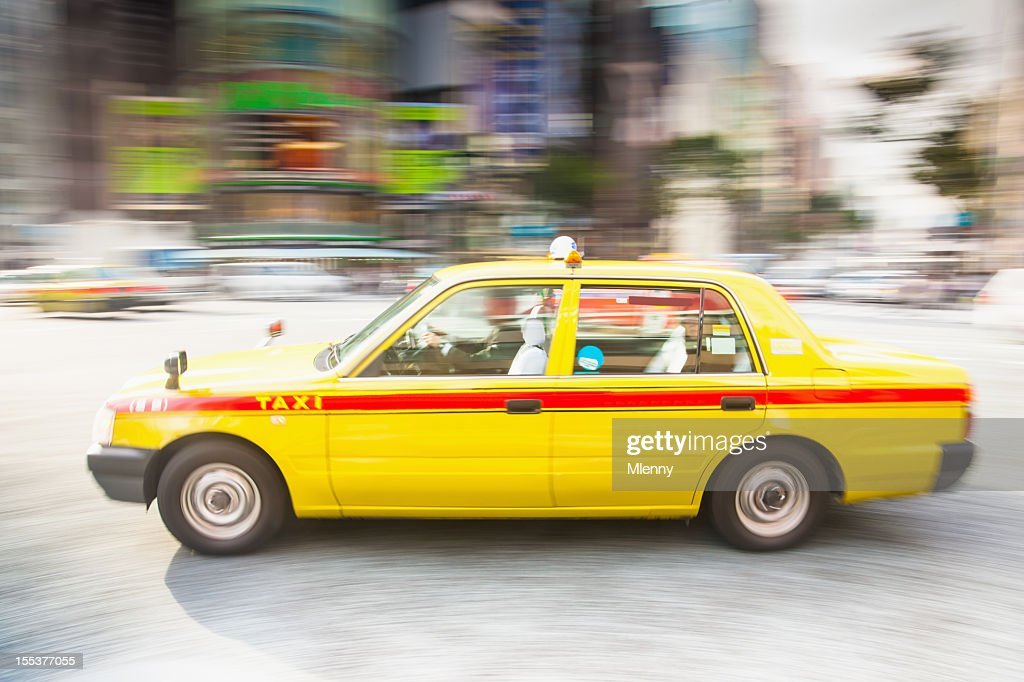 Speeding Taxi in Tokyo City : Stock Photo