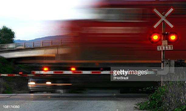 speeding train at railroad crossing, motion blur - railroad crossing stock pictures, royalty-free photos & images