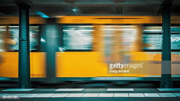 speeding train on berlin subway - ubahn stock-fotos und bilder