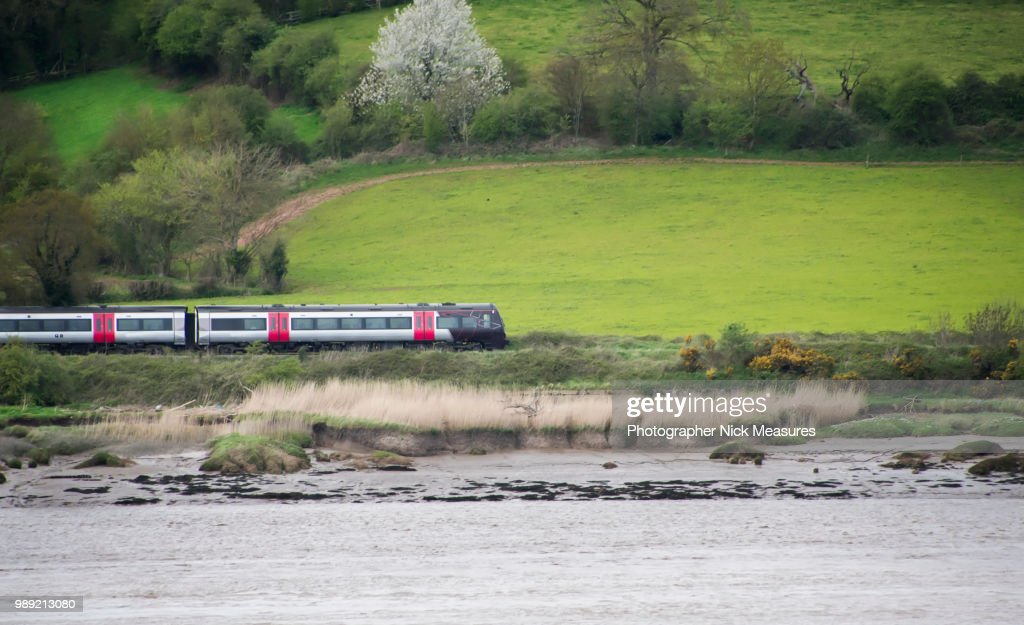 Speeding Train Running Through The English Country side. : Stock Photo