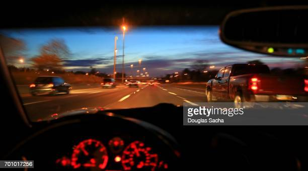 speeding vehicle on a busy highway - dashboard camera point of view stock photos and pictures