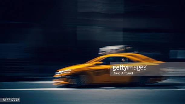 Speeding yellow New York taxi or cab