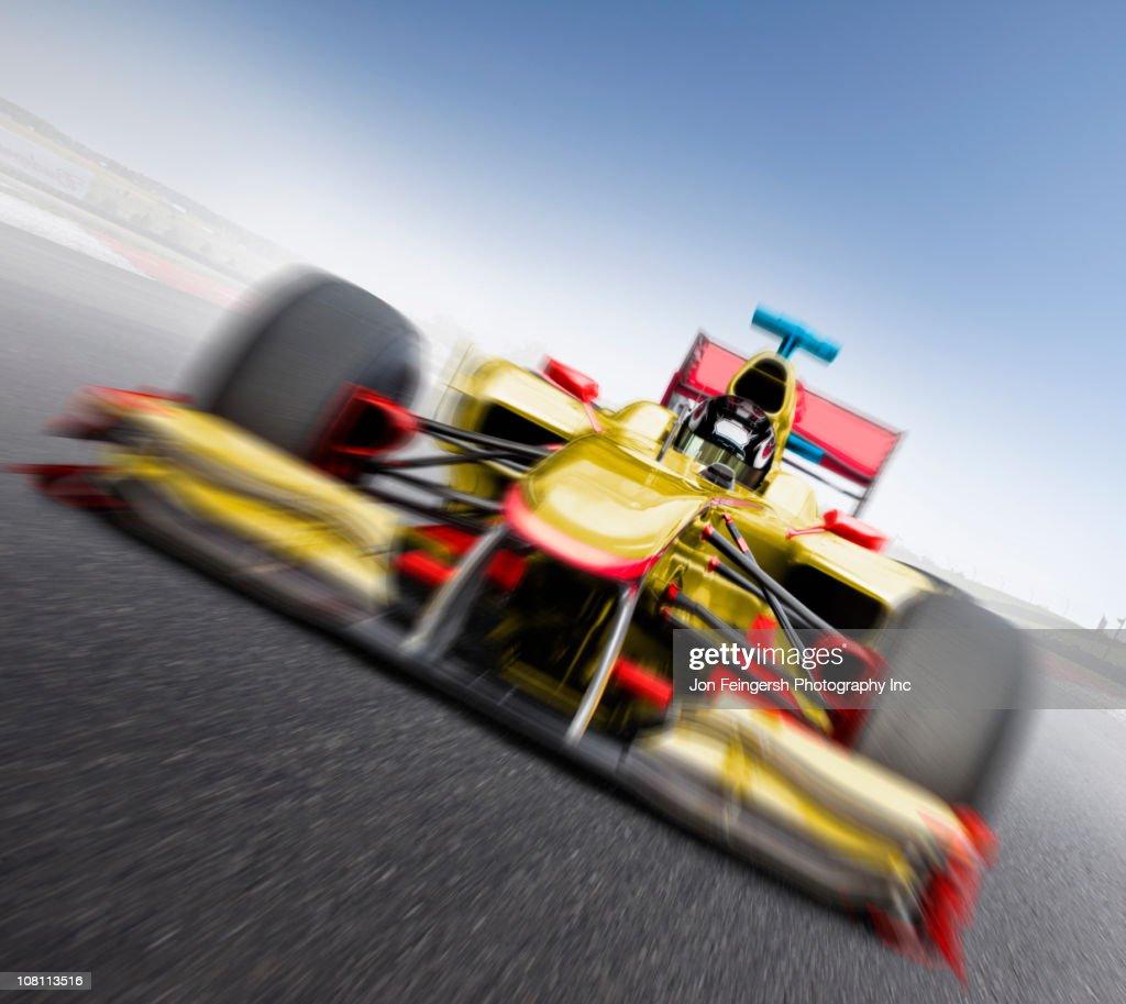 Speeding yellow race car : Stock Photo